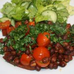 Kapucijners met chorizo en tomaten